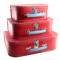 red paper suitcases